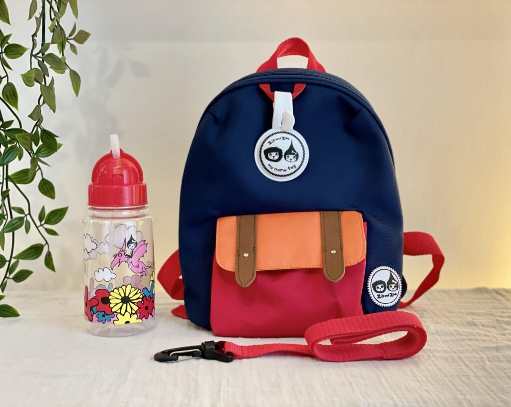 Zip and Zoe mini backpack in navy colourblock with straw water bottle