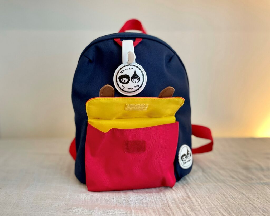 Zip and Zoe mini backpack in navy colourblock - front pocket