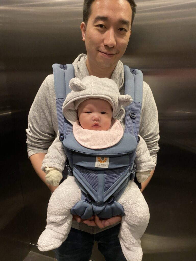 Father carry baby in the Ergobaby 360