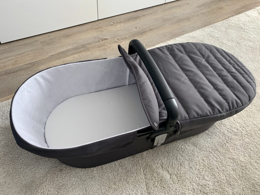 iCandy Raspberry Carry Cot without hood on the floor