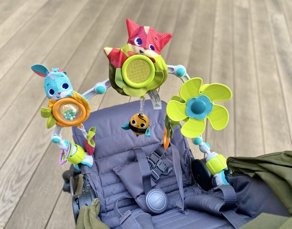 Author's Amazon Tiny Love buggy arch toy attached to buggy