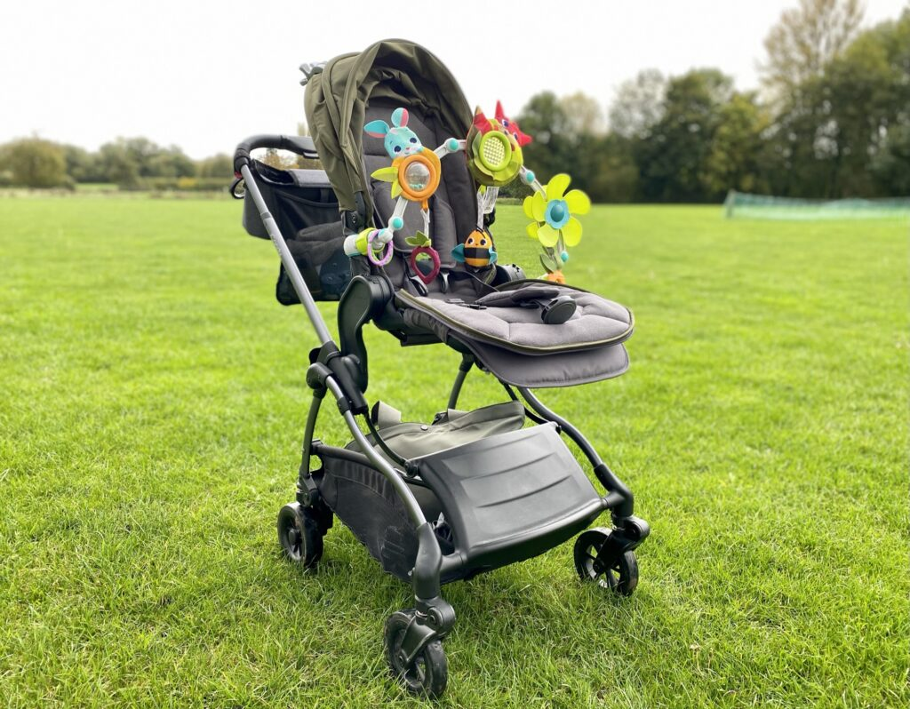 iCandy Raspberry Pushchair in Kings Road Khaki with toy arch attached