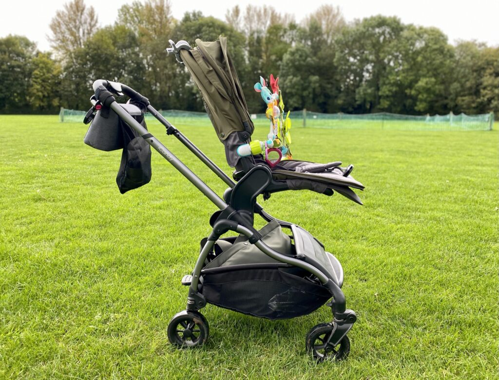 iCandy Raspberry Pushchair in Kings Road Khaki - side view with elevators on the grass