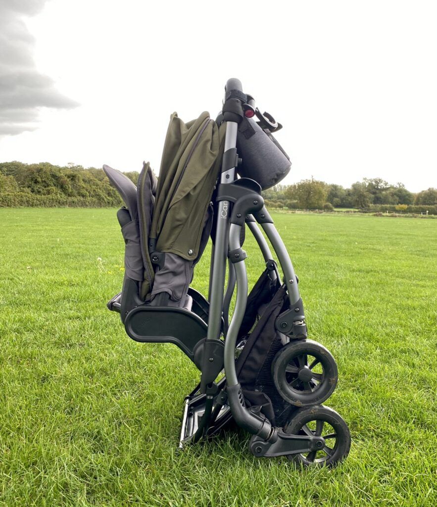 iCandy Raspberry Pushchair in Kings Road Khaki - folded with elevators on the grass