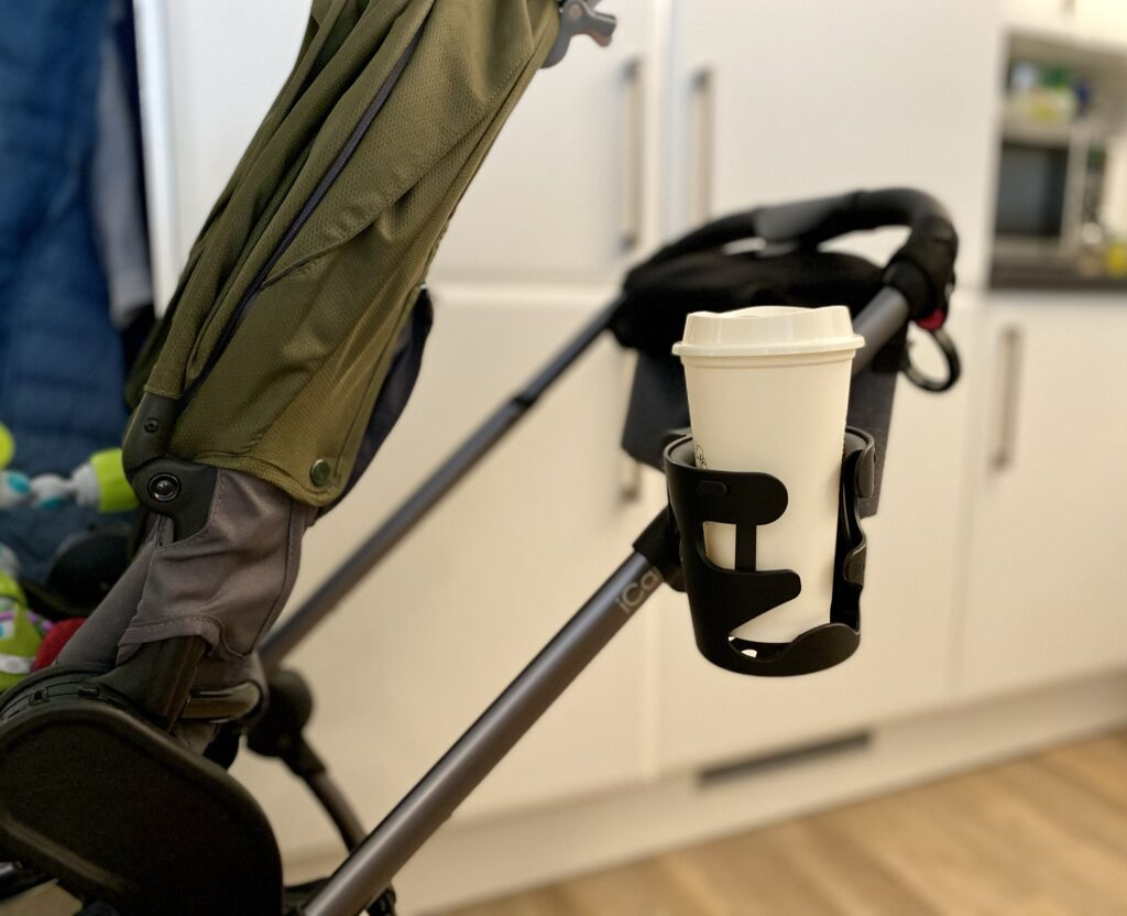 Author's iCandy universal cup holder attached to pushchair frame holding grande/medium coffee shop cup