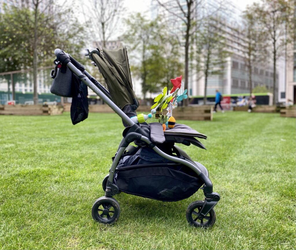 iCandy Raspberry Pushchair in Kings Road Khaki - side view without elevators on the grass