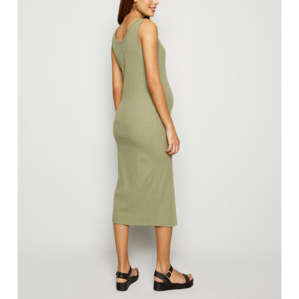 Model wearing New Look ribbed bodycon maternity dress in khaki - back view