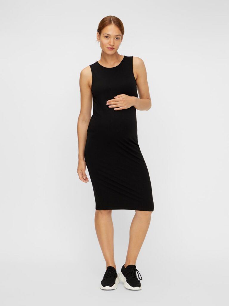 Model wearing Mamalicious sleeveless bodycon maternity dress in black - front view