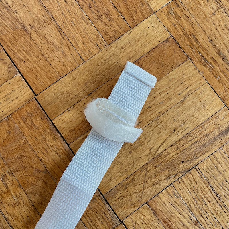 Author's Chicco Pocket Snack Booster Seat strap showing velcro
