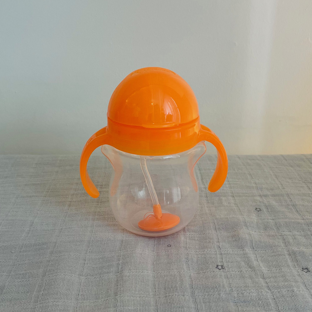 Munchkin click lock straw bottle in orange closed lid