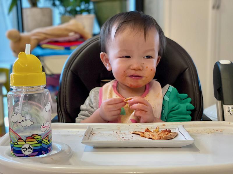 Boy eating tortilla pizza 3