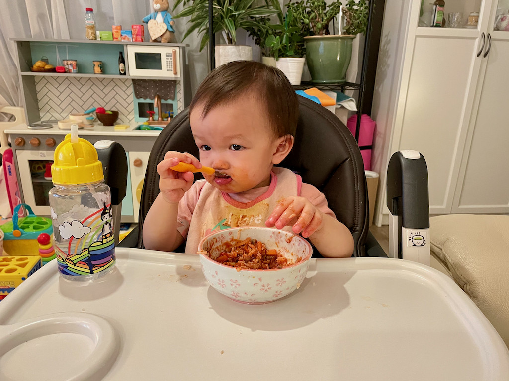 Boy eating meat sauce 3