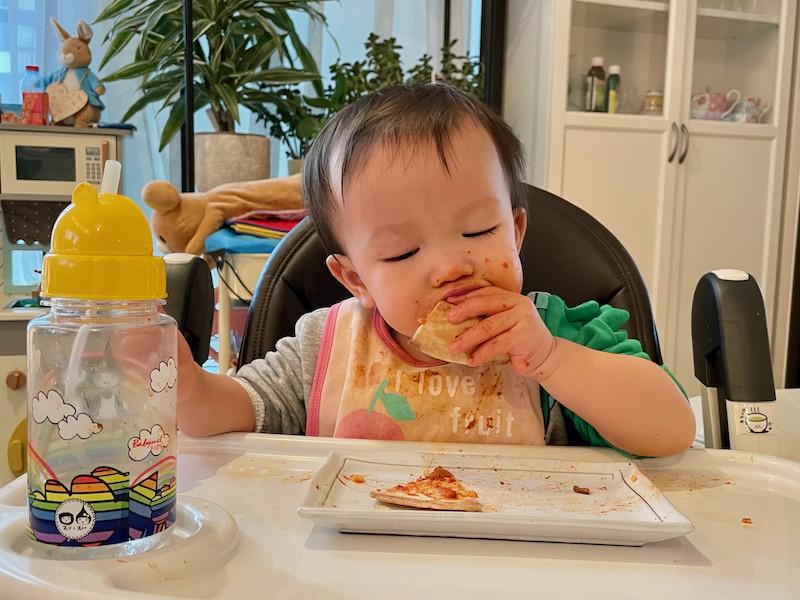 Boy eating tortilla pizza 2