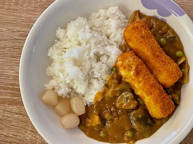 Japanese curry served with fish fingers