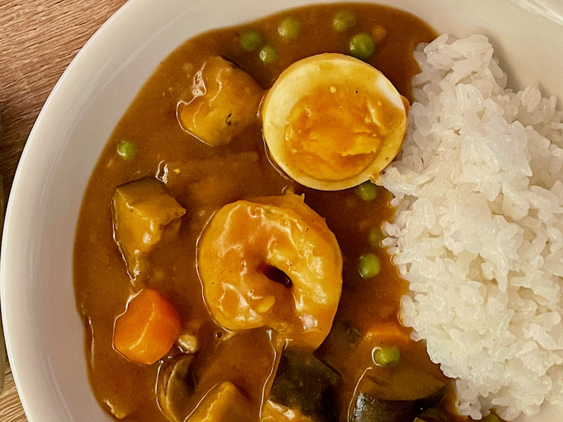 Japanese curry servies with prawn and boiled egg