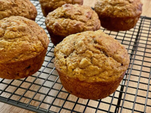 Banana Carrot Chia Seed Muffins from an angle on wire rack