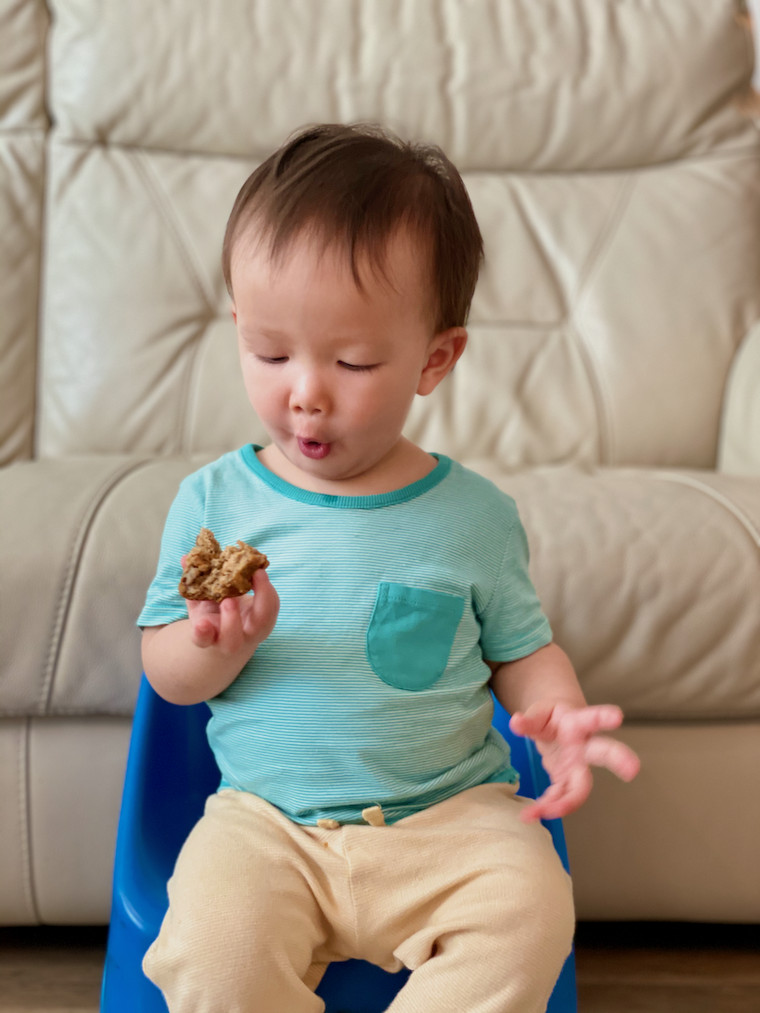 Boy eating ABC muffin 3