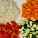 Onion, carrot, tomatoes and courgette diced