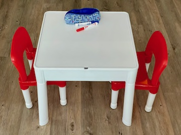 Table showing whiteboard side of table with pens