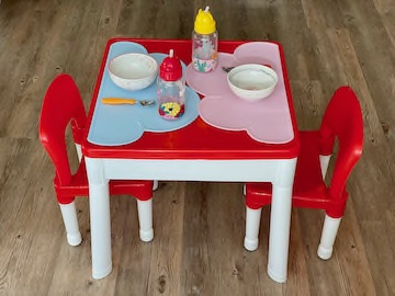 Table with set up for toddler dining