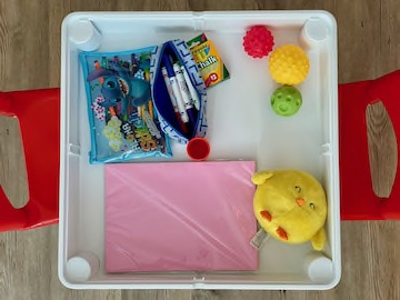Table with toys stored inside