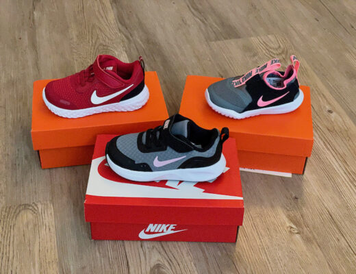 3 pairs of Nike trainers on boxes