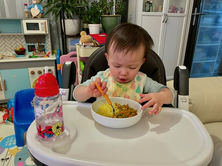 Boy eating 3 spice curry 1