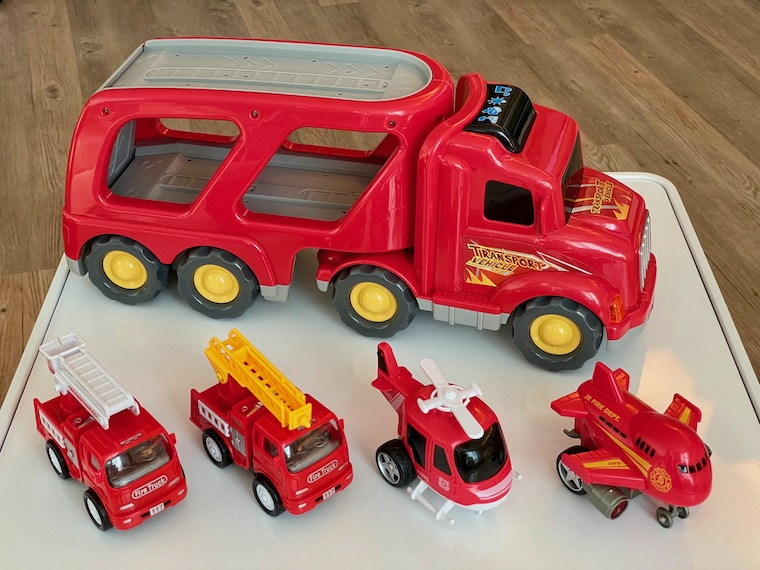 Fire Engine Toy with little toys lined up