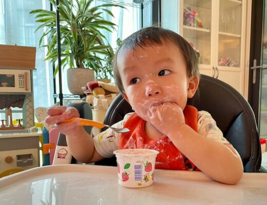 Boy eating yogurt - feature image